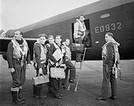 Wing Commander Guy Gibson (in door of aircraft) and his crew board their Avro Lancaster bomber for No. 617 Squadron's raid on the Ruhr Dams, 16 May 1943. CH18005.jpg