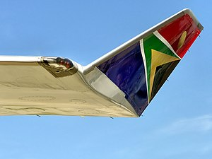 Wing tip - The winglet and red navigation light on the wing tip of a South African Airways Boeing 747-400