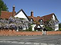 Wisteria covered house - geograph.org.uk - 421456.jpg
