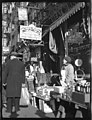 Woman selling many kinds of cake at 164 Orchard Street, New York. (4520858971).jpg