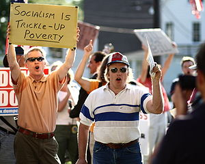Protesters at a health care reform town hall m...