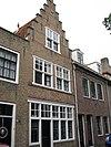 foto van Logegebouw: huis met gepleisterde (gemutileerde) trapgevel