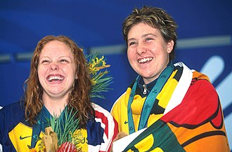 Alicia Aberley - Aberley (right) and fellow Australian swimmer Siobhan Paton smiling and celebrating their achievements on the medal podium at the 2000 Summer Paralympics