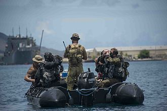 Clearance Diving Branch (RAN) - Clearance Divers prepare to enter the water during a Very Shallow Water (VSW) scenario during Exercise Tricrab 2016 in Guam