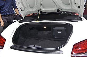 Trunk (car) - The open trunk in the rear of a Porsche Boxster