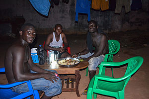 Cuisine of Guinea-Bissau - People sharing a meal in Bissau, the capital.