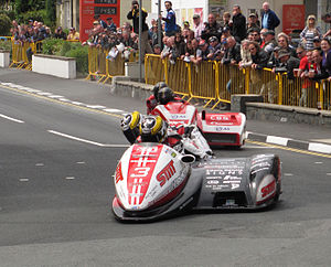 Parliament Square, Ramsey - Tim Reeves/Dan Sayle (3) leading Dave Molyneux/Patrick Farrance (1) through Parliament Square in race 1 of the 2013 Isle of Man TT Sidecar Race