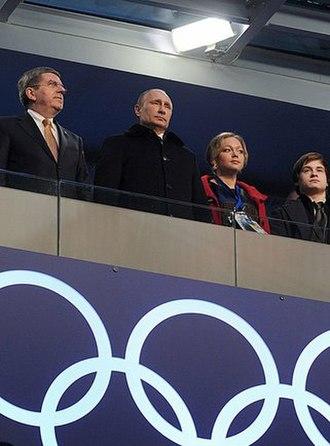 Russia at the 2014 Winter Olympics - Thomas Bach, President Vladimir Putin and bobsledder Irina Skvortsova at the opening ceremony