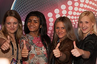 Latvia in the Eurovision Song Contest 2015 - Aminata with backing vocalists at a press meet and greet.