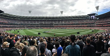 An aerial view of the Melbourne Cricket Ground during the 2018 AFL Grand Final, packed with 100,000 people 2018 AFL Grand Final panorama.jpg