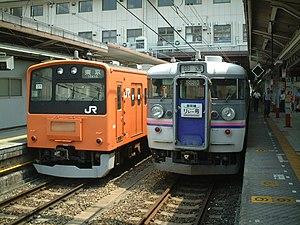 Shinkansen Relay - 165 series EMU on a Shinkansen Relay rapid service at Hachiōji Station, August 2001