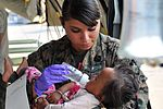 435673-V-CSB22-727 - HM2 Jessica Gomez-Hickman treats infant.jpg