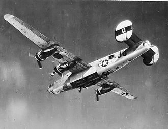 """Willow Run Airport - """"Queenie"""" Willow Run built B-24J-5-FO Liberator, AAF Ser. No. 42-50773, assigned to the 707th Bombardment Squadron, 446th Bombardment Group, Eighth Air Force on a bomb run over Aschaffenburg, Germany, on February 25, 1945, attacking railroad marshalling yard facilities"""