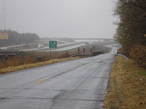 "Frontage road - A frontage road for I-49/US 71 (a freeway) near Carthage, Missouri.  The frontage road (called an ""outer road"" in Missouri) is former U.S. Route 71 Alternate.  A second frontage road on the opposite side of the freeway is visible and was built during construction of the freeway."