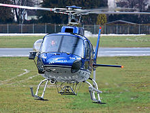 A Eurocopter AS350 helicopter with a belly hook installed.