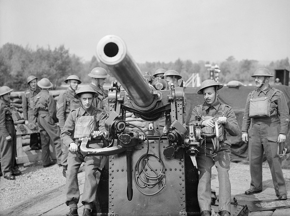 A 3-inch gun crew of 303rd Battery, 99th Anti-Aircraft Regiment, Royal Artillery, at Hayes Common in Kent, May 1940. H1387