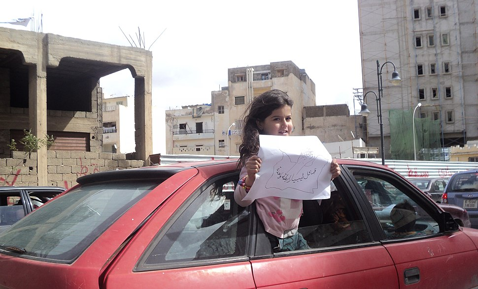 A Benghazi girl holding a paper