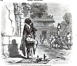 A Brahmin standing praying in the corner of the streets 1863.jpg