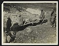 A British Tommy helping a German carry a German wounded man through the trenches, Bestanddeelnr 158-1039.jpg