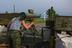 A Russia-backed rebel guards his position near the division line with Ukrainian army with anti-tank missile-near Dokuchaevsk, eastern Ukraine, Friday, June 5, 2015.jpg