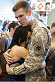 A Soldier, right, from 45th Infantry Brigade Combat Team, Oklahoma Army National Guard, is reunited with a family member, during a homecoming ceremony in Oklahoma City, April 1, 2012 120401-A-ZW424-466.jpg