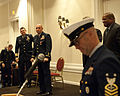 A U.S. Coast Guard command master chief petty officer speaks during the retirement ceremony for Chief Warrant Officer Mario Vittone in Portsmouth, Va., Jan. 11, 2013 130111-G-VS714-336.jpg