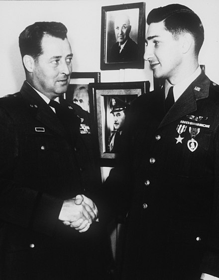 U.S. Air Force pilot receiving the Purple Heart and Silver Star during the Korean War.