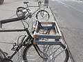 A bike customized for carrying both children and cargo... (47211816642).jpg