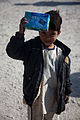 A boy in Ananzai village, Kandahar province, Afghanistan, holds up a handheld radio he received from U.S. Soldiers attending the opening of the village's new school Dec. 26, 2011 111226-A-VB845-044.jpg
