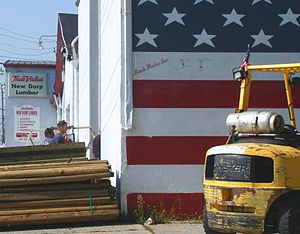 True Value - A worker enters a True Value lumberyard in New Dorp, Staten Island.The lumberyard shut down in 2009