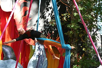 "Aerial silk - Christianne ""Flip"" Sainz of Aerial Angels performing aerial silk at King Richard's Faire, a renaissance faire in Massachusetts."
