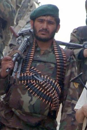 Bandolier - Modern Afghan National Army soldier wearing a belt of ammunition.