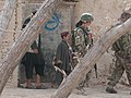 Afghan National Army soldiers exit a cleared house while conducting a dismounted patrol in Panjwai district, Kandahar province, Afghanistan, April 1, 2012 120401-A-VQ566-461.jpg