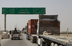 Trucks wait to cross into Iran at the Zaranj border crossing.