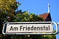 Am Friedenstal, Hannover-Misburg-Nord, Straßenschild vor dem Kurhaus Friedenstal.jpg