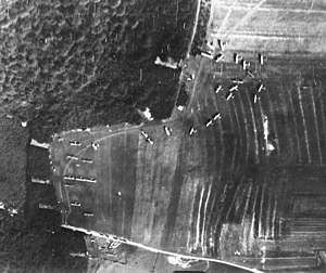 Amanty Airdrome - Photo of Amanty Airdrome in 1918, looking from the southwest.   Many Salmson 2A2 observation planes are parked on the grassy airfield.  Note the D 168 road crossing the field.   Most of the station buildings are in the forest to the north (left side of the photograph).