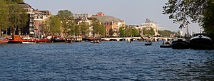 A panorama of the river Amstel in the city's centre of Amsterdam, the Netherlands. Visible are the famous Skinny Bridge and the theatre Carre.