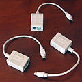 An image of 3 Farallon PhoneNet AppleTalk adapters.jpg