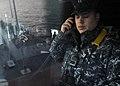 An officer stands watch aboard USS Blue Ridge. (8476432574).jpg
