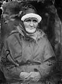 An old woman wearing a hat and a shawl NLW3365018.jpg