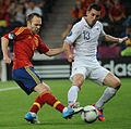 Andrés Iniesta and Anthony Réveillère Spain-France Euro 2012.jpg