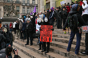 Anonymous (group) - Anonymous protestors at the Brussels Stock Exchange, Belgium, January 2012