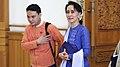 Aung San Suu Kyi with NLD people in Burmese Parliament.jpg