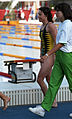 Australian swimmer walking on the pool deck.jpg