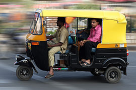 Auto rickshaw, also called Tuk-Tuk,[1] tempo, mototaxi and three wheeler, carry people and goods in many developing countries. Above are six examples. - Auto rickshaw