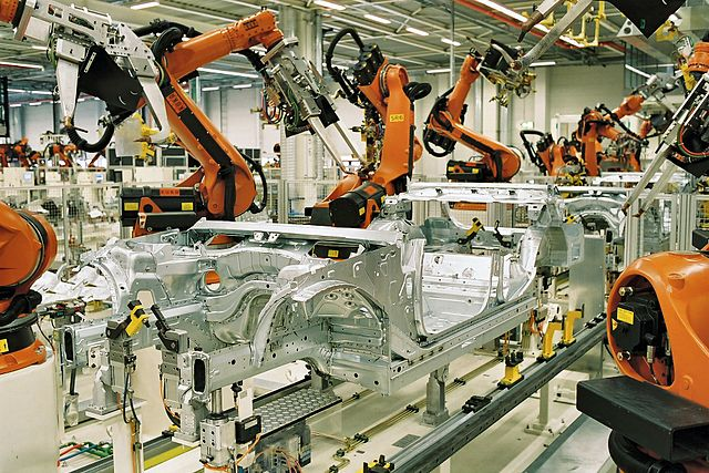 Spot welding of BMW 3 series car bodies with KUKA industrial robots.