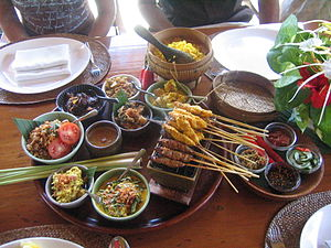 Balinese cuisine - Examples of Balinese dishes, such as sate lilit, nasi kuning, lawar, and lalah manis sambal condiment