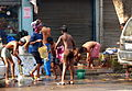 Bathing on Ganesh Chandra Ave. (14839550515).jpg