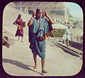 Benares - woman walking; stone steps in background LCCN2004707771.jpg