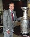 Bob Martinez standing with the NHL Stanley Cup trophy in Tampa.jpg